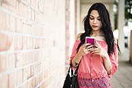 Young woman using smart phone - JASF000796