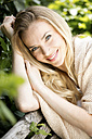 Portrait of smiling blond woman - GDF001012