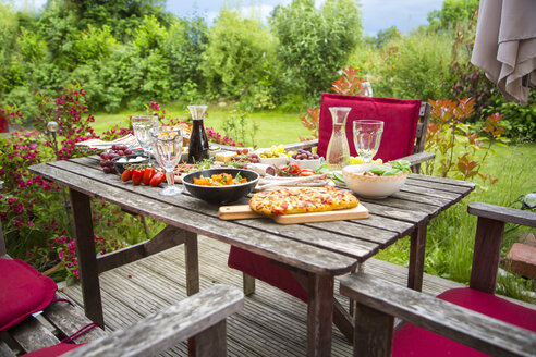 Variety of Mediterranean antipasti on garden table - SARF002763