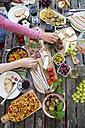 People enjoying variety of Mediterranean antipasti - SARF002766