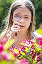Portrait of girl looking through magnifying glass - SARF002773