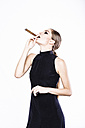Stylish woman smoking a cigar - MRAF000070