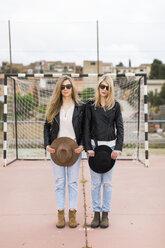 Two women standing on sports field - JPF000163
