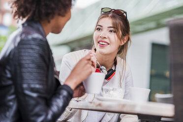 Two best friends talking in a cafe - UUF007644