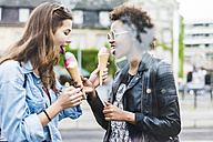 Two best friends eating icecream together - UUF007665
