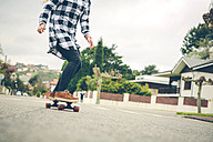 Young woman skateboarding on the street - DAPF000125