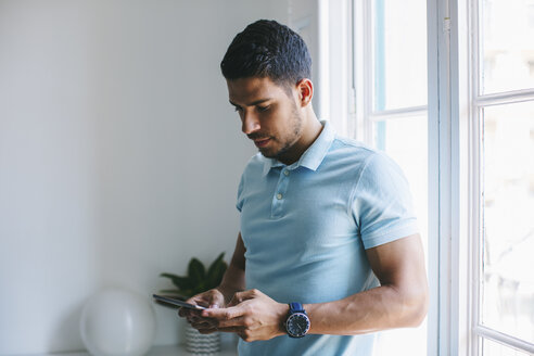 Young businessman in office using digital tablet - EBSF001511