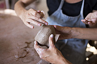 Man and woman in workshop working on pottery - KNTF000360