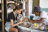 Man and woman in workshop working on pottery - KNTF000366