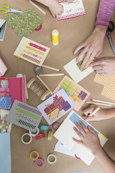 Hands making greeting cards - NHF001523