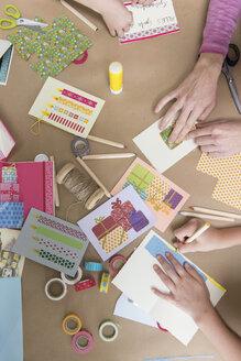 Hands making greeting cards - NHF001523
