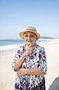 Portrait of senior woman standing on the beach - RAEF001220