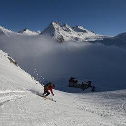 Italy, Adamello, Rifugio Mandrone, Cima Presanella, skier - ALRF000531
