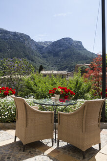 Wicker chairs on a terrace, mountains in the background - ABZF000694
