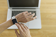 Woman with smartwatch and laptop - SBOF000079