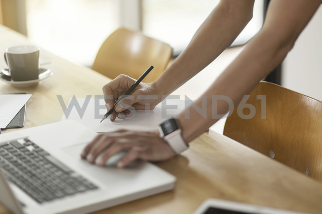 Woman at table with laptop taking notes - SBOF000085 - Steve Brookland/Westend61