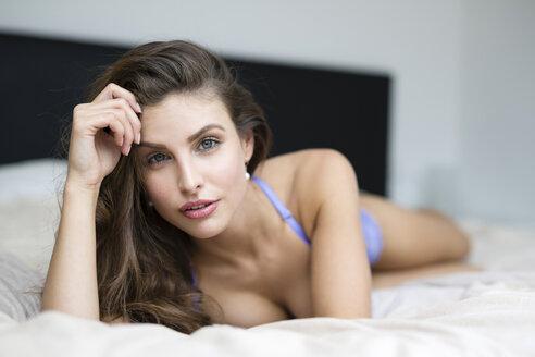 Woman in lingerie lying on bed - SHKF000608