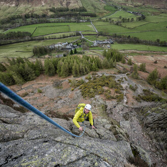 England, Cumbria, Lake District, Langdale, Raven Crag, Middlefell Buttress, climber - ALRF000539