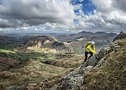 England, Cumbria, Lake District, Langdale, Harrison Stickle, climber - ALRF000545