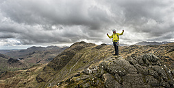 England, Cumbria, Lake District, Langdale, Harrison Stickle, climber - ALRF000548