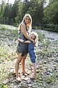 Mother and her little daughter hugging together in nature - TCF005005