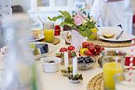 Healthy food on laid table - MJF001838