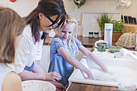 Mother and two girls washing the dishes in kitchen - MJF001859
