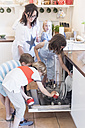 Mother and four children loading the dishwasher - MJF001862