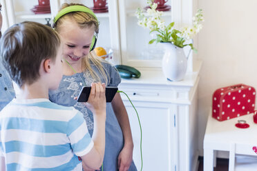 Children with cell phone and headphones - MJF001877