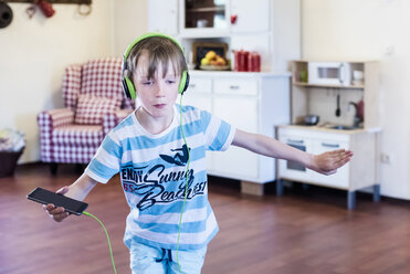 Boy with cell phone and headphones dancing - MJF001880