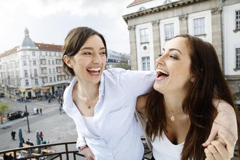 Two happy women on balcony - FKF001889