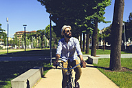 Young man riding bicycle - FMOF000001