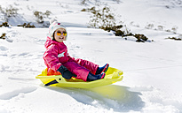 Spain, Asturias, girl with sledge in the snow - MGOF001969