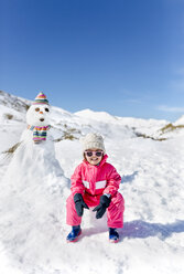 Spain, Asturias, Girl builded a snowmen - MGOF001975