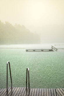 Germany, Bavaria, Burghausen, summer rain at Woehrsee, bathing jetty - HAMF000208