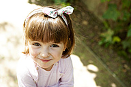Portrait of smiling little girl with hair ribbon - VABF000587