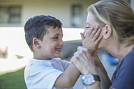 Little boy stroking his mother's face - ZEF008737