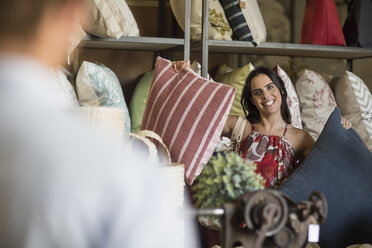 Couple shopping for pillows in vintage store - ZEF008755