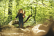 Girl playing in forest - SBOF000133