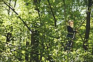 Girl in forest climbing in tree - SBOF000145