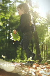 Girl in forest walking with leaves - SBOF000154