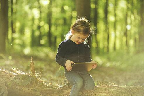 Girl in forest using digital tablet - SBOF000160
