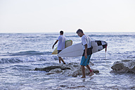 Indonesia, Bali, Surfers going into the water - KNTF000378