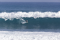 Indonesia, Bali, Surfer on a wave - KNTF000381