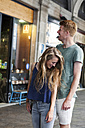 Happy couple standing in front of a coffee shop - VABF000610