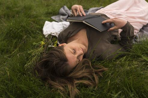 Woman relaxing on a meadow - BOYF000454