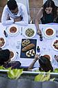 Friends enjoying a summer dinner in a terrace - ABZF000723