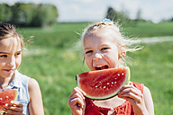 Two girls outdoors eating slices of watermelon - MJF001906