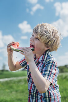 Boy outdoors eating slice of watermelon - MJF001909
