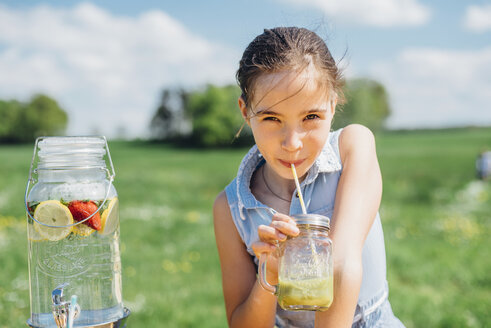 Girl outdoors drinking from jar - MJF001918